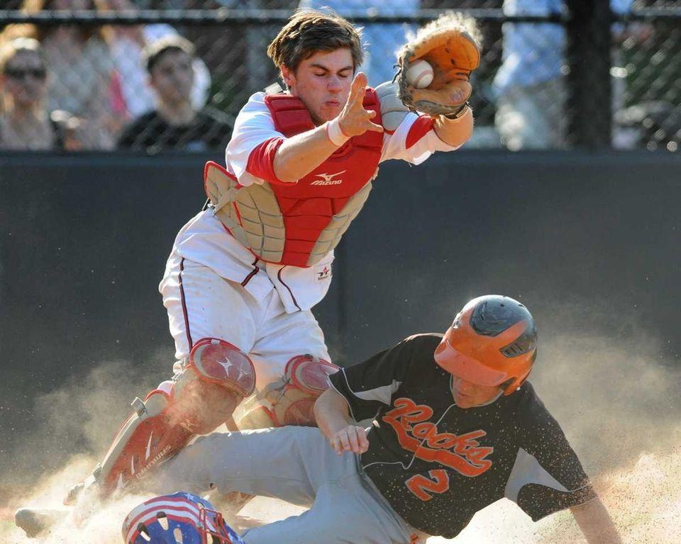 East Rockaway second baseman Vincent Celeste scores a