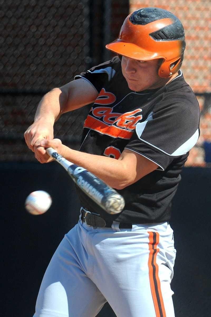 East Rockaway right fielder David McClure drives in