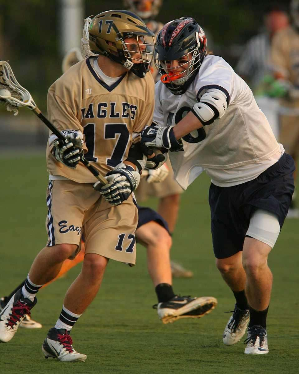 Manhasset's James Farrell lays a hit on Bethpage's
