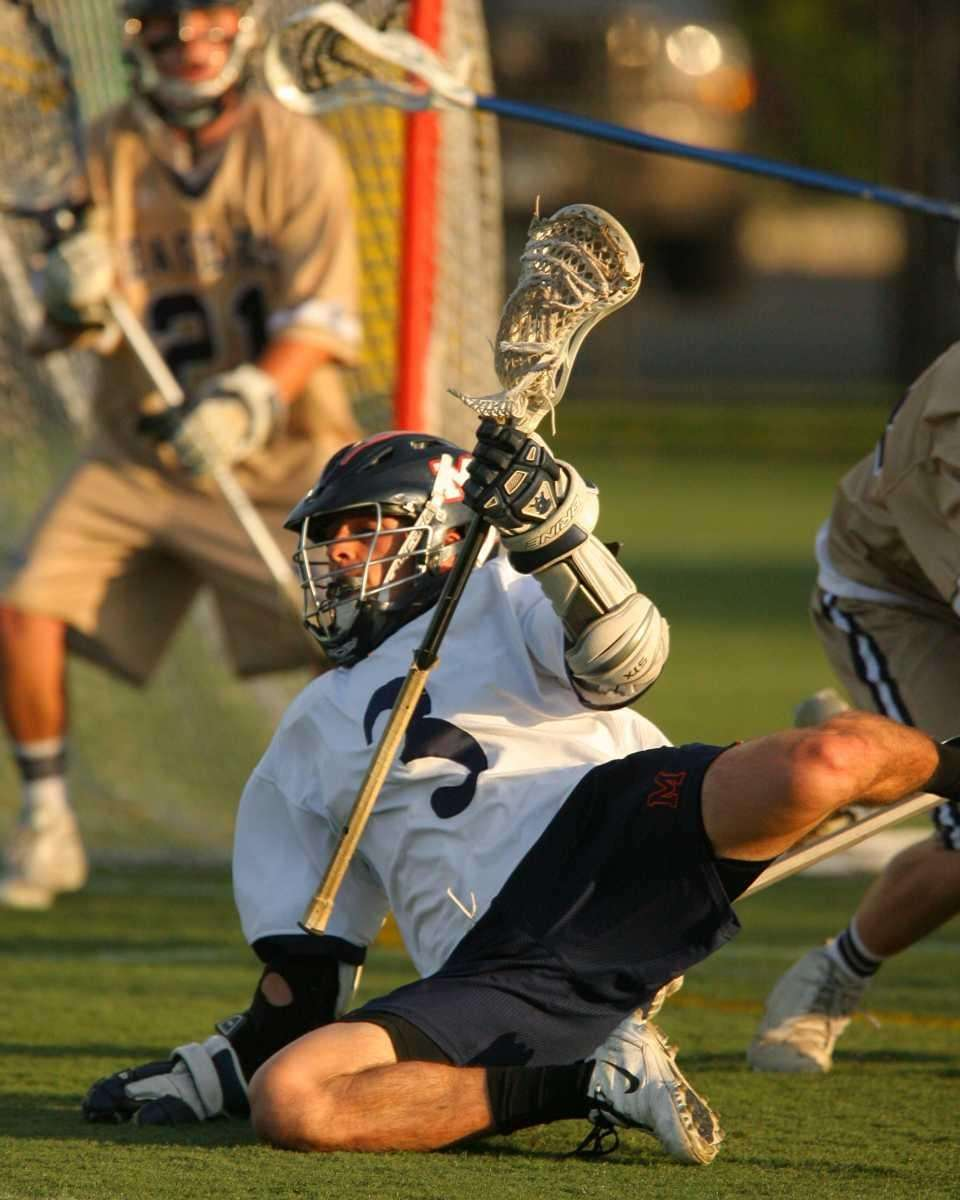 Manhasset's Dino Lavelle goes down but keeps control