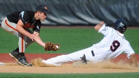 East Rockaway shortstop Sean Bohan, left, tags out