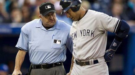 Derek Jeter talks with home plate umpire Dale