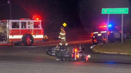 Firefighters at the scene of a motorcycle crash