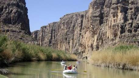 Rafts piloted by guides from Far Flung Outdoor