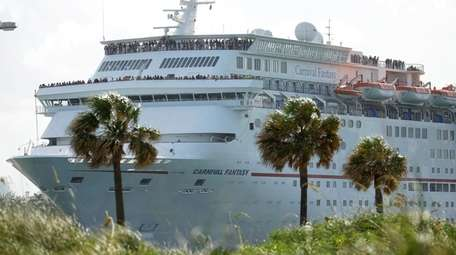 A Carnival Fantasy cruise ship leaves PortMiami, in