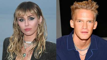 Singers Miley Cyrus and Cody Simpson, pictured above