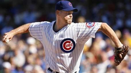 Chicago Cubs pitcher Kerry Wood delivering a pitch
