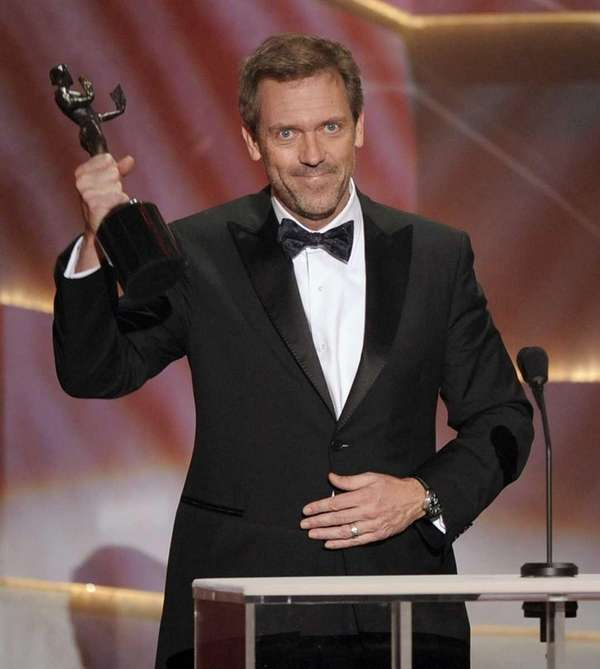 Actor Hugh Laurie accepts the award for Outstanding