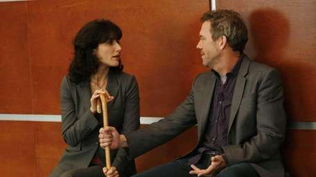 House (Hugh Laurie) and Cuddy (Lisa Edelstein) come