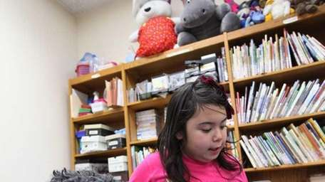 Tank, a 9-year-old standard poodle, makes an attentive