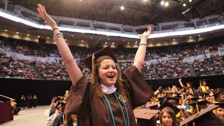 Michelle Cifelli, of Mineola, cheers with the Adelphi