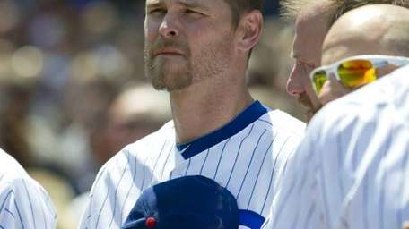 Chicago Cubs relief pitcher Kerry Wood stands on