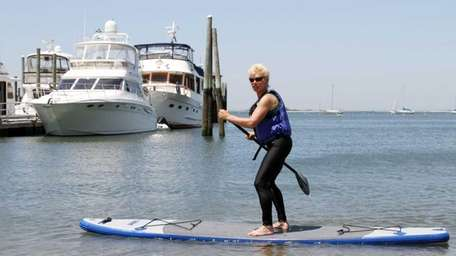 loria Neumair, of Port Jefferson, Paddles on a
