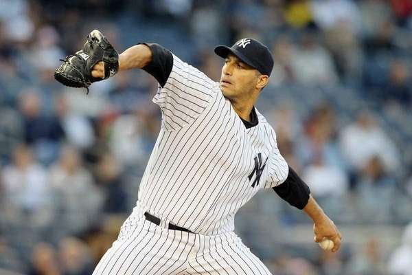 Andy Pettitte pitches against the Cincinnati Reds. (May