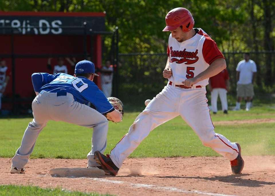 Connetquot's Steven Schmitt gets safely back to the