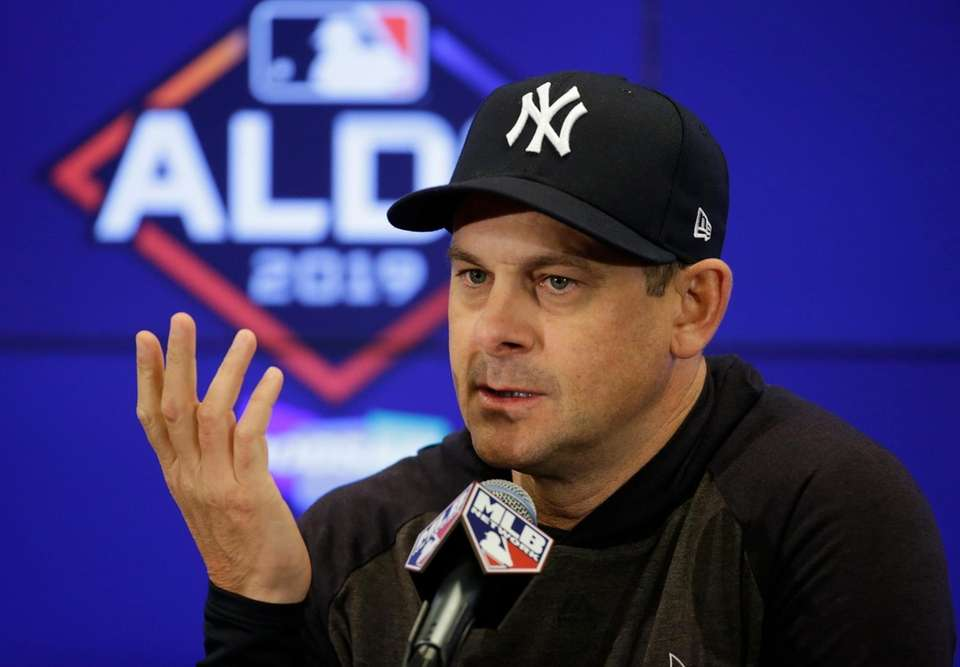 New York Yankees manager Aaron Boone (17) speaks