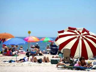 Umbrellas line the beach at Jones Beach. The