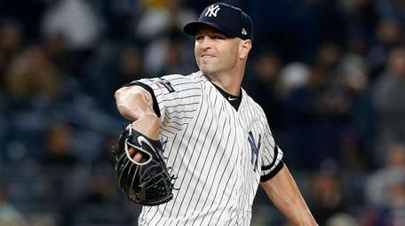 J.A. Happ of the Yankees pitches in the