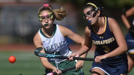 Bridget Rosenfeld of Massapequa, right, gets pressured by