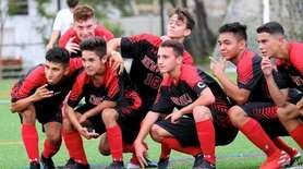 Newfield midfielder Sonny Farrell, second from left, celebrates