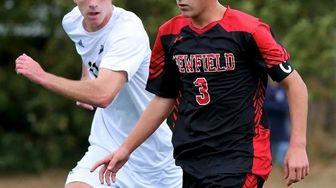Newfield midfielder Lorenzo Selini moves the ball through
