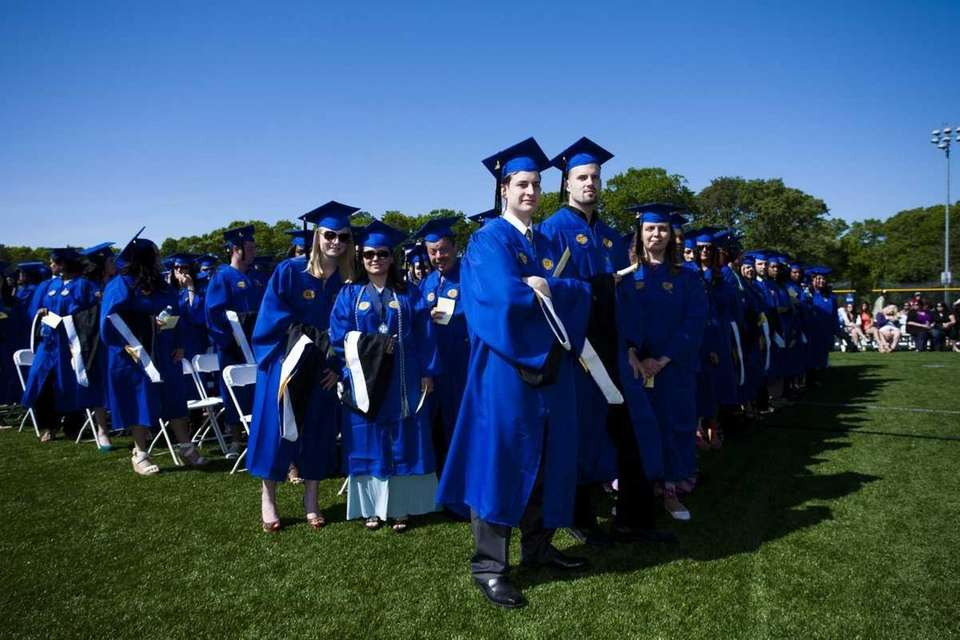 Students participate in Dowling College's 50th commencement ceremony.