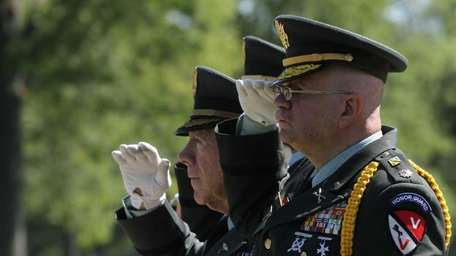 Members of an Honor Guard salute during a