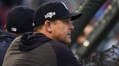 Yankees manager Aaron Boone looks on during