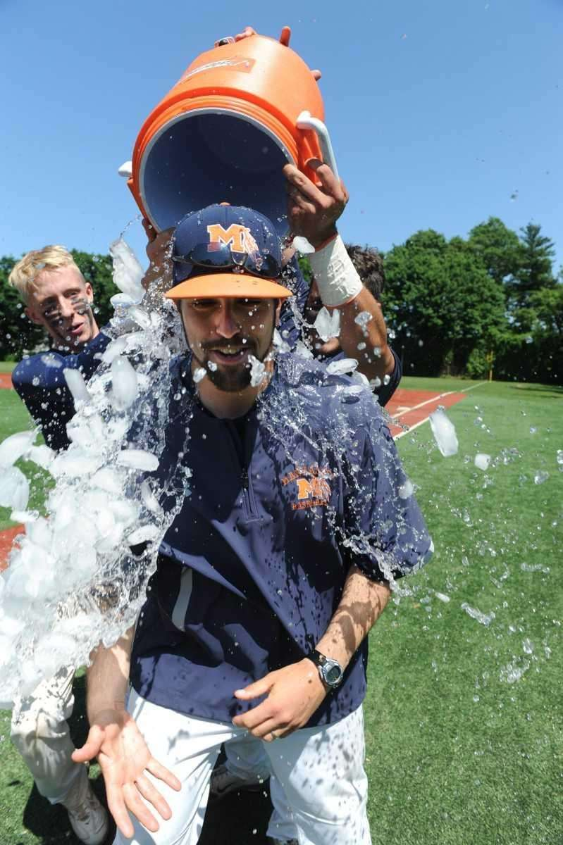 Manhasset players dump a Gatorade cooler of ice