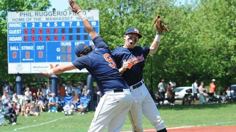 Manhasset players Harrison Felman, left, and Tim Curtis
