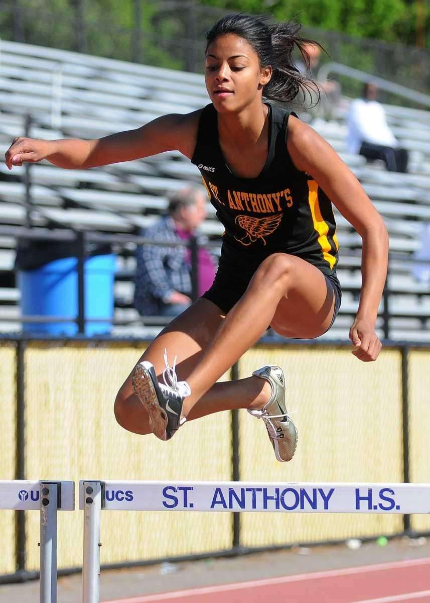 St. Anthony's senior Olicia Williams leaps over an
