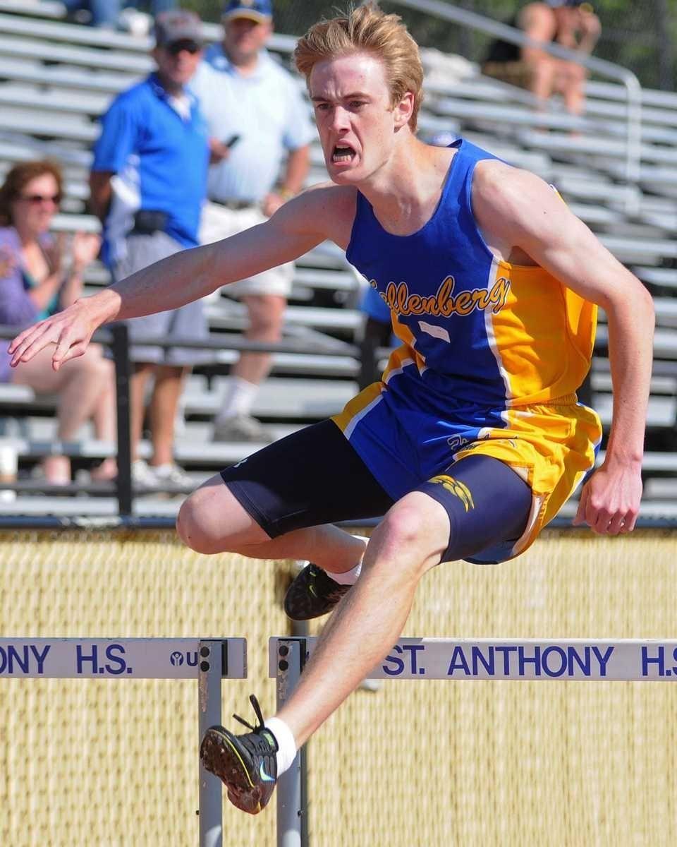 Kellenberg senior Connor Barrett leaps over an obstacle