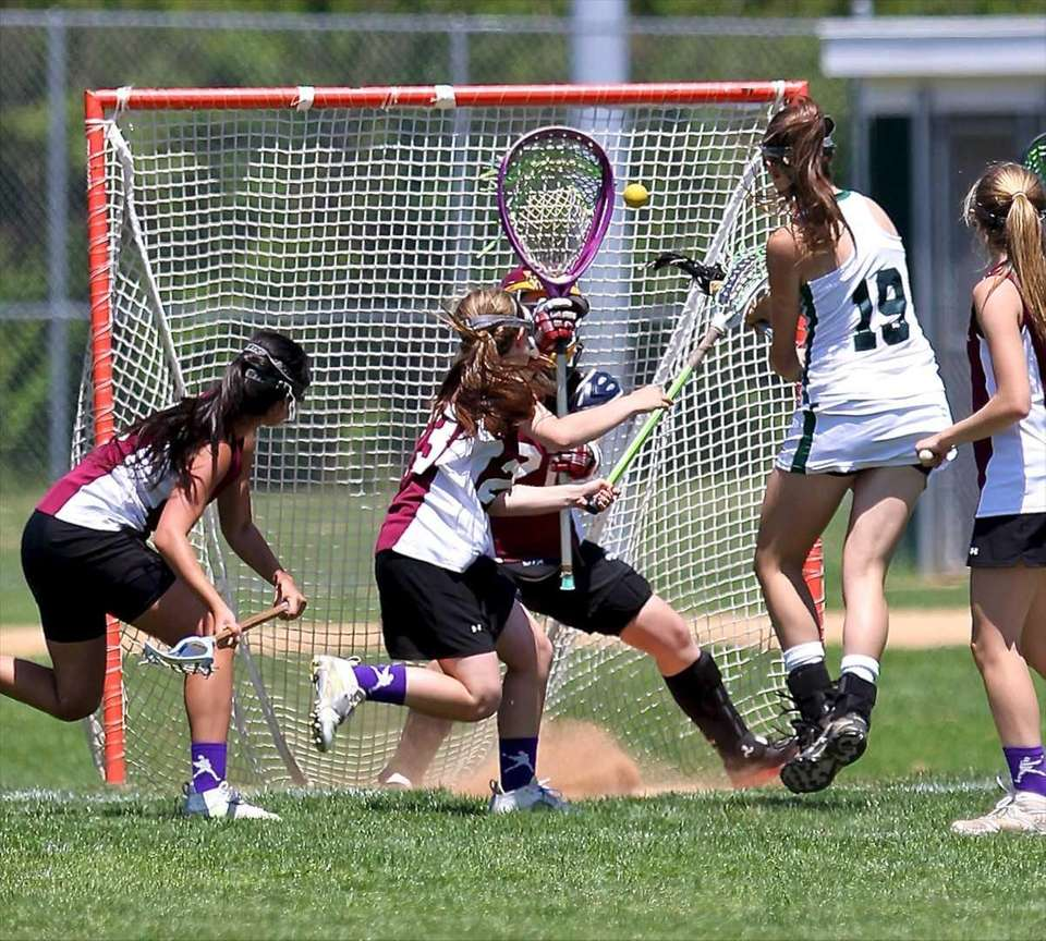 Harborfield's Kasey Stolba scores against Kings Park's Amanda