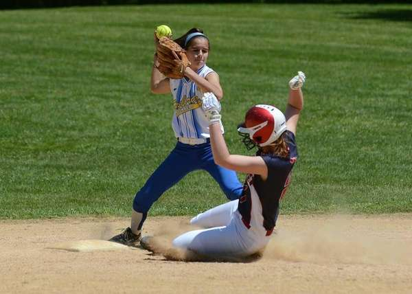 Kellenberg's Krista King gets the force out at