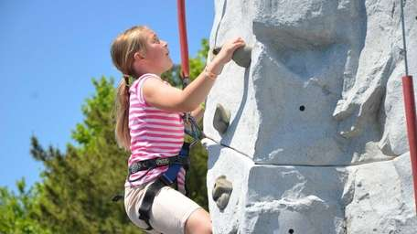 Liliana Parise, 10, of Glenwood Landing, climbs the