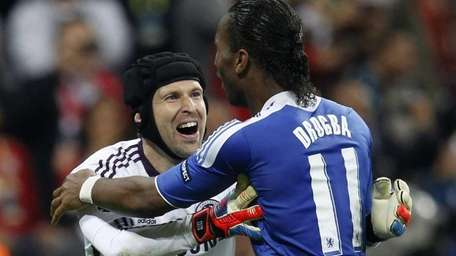 Chelsea's Didier Drogba celebrates with goalie Petr Cech