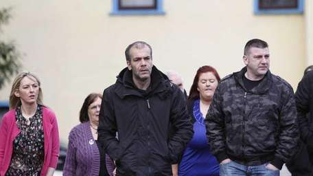 Colin Duffy, center, walks outside Lisburn courthouse in