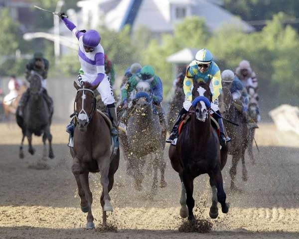 Jockey Mario Gutierrez, left, aboard, I'll Have Another,