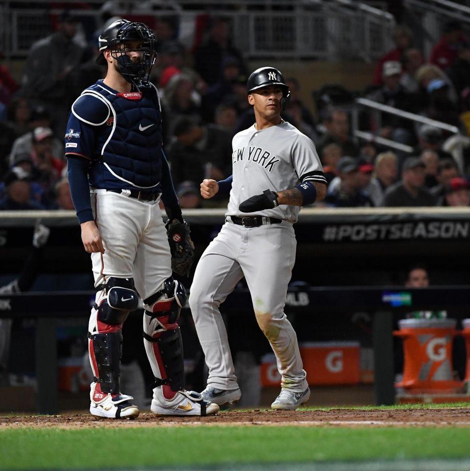 Yankees second baseman Gleyber Torres scores on the