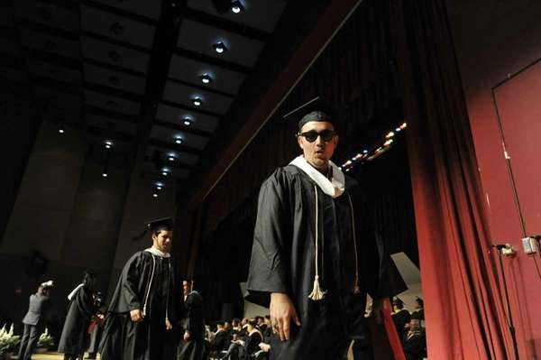 Brendan McGrath walks in the graduation ceremony for