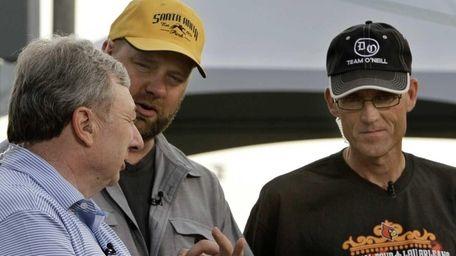 Kentucky Derby winning trainer Doug O'Neill, center, talks
