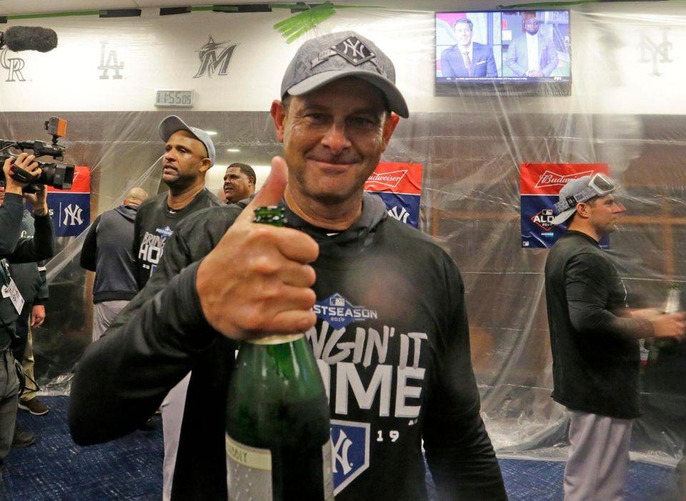 New York Yankees manager Aaron Boone (17) celebrates