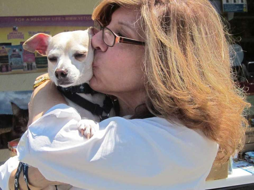 Nancy Buckler, of Islip, gives a smooch to