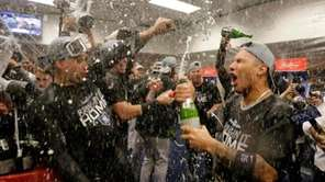 Inside the winningclubhouse after the Yankees sweep the