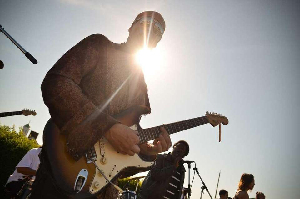 Guitarist Jonathan Fritz performs with the funk band,