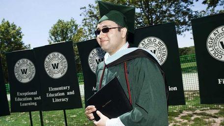 Michael Arroyo, 24, of Farmingdale, receives his master's