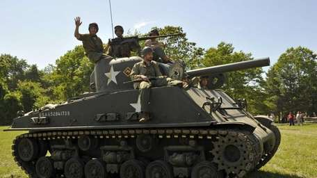WWII enthusiasts ride a Sherman Tank on the