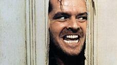 "Heeere's Jack Nicholson in Stanley Kubrick's ""The Shining."""