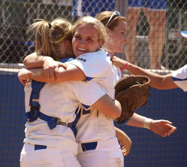 Pitcher Olivia Galati hugs catcher Courtney Crews after