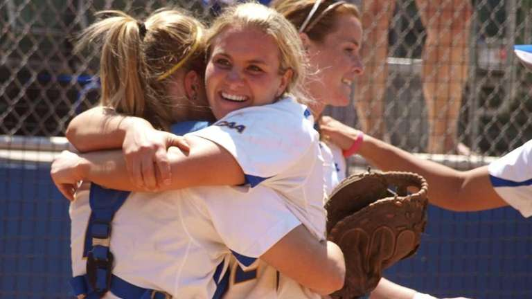 Pitcher Olivia Galati hugs catcher Courtney Crews after